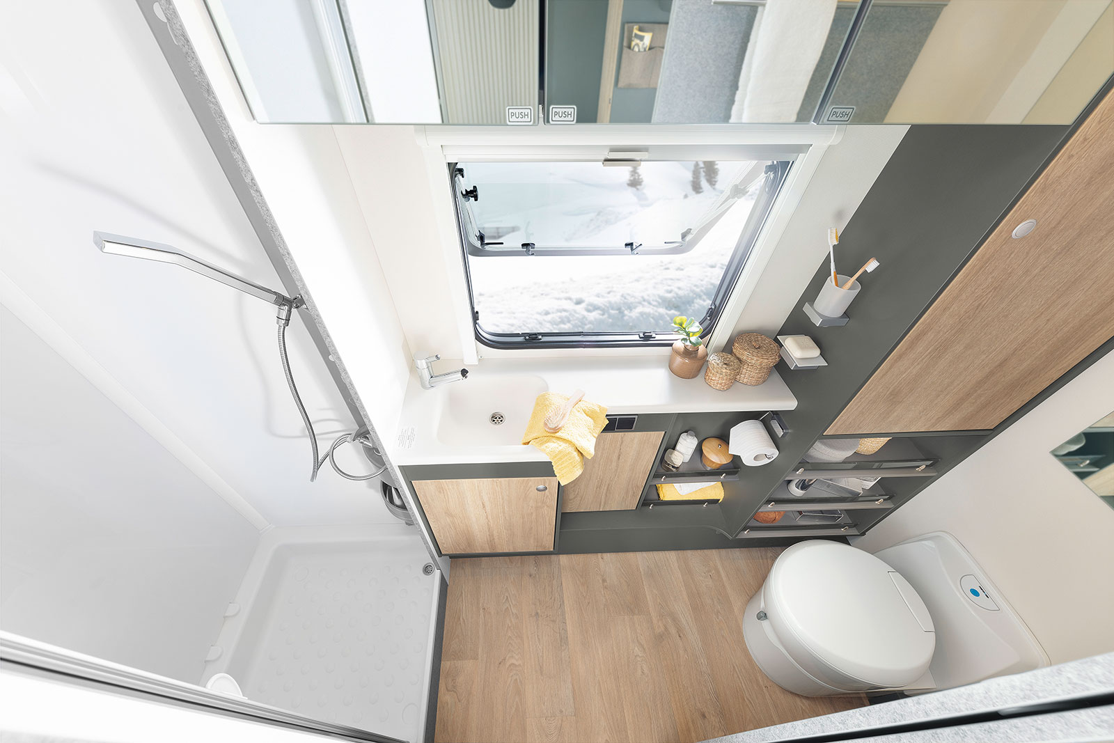 The bathroom, which stretches across the entire width of the vehicle with an integrated shower, is the perfect place to start your day • 690 BQT | Tarragona