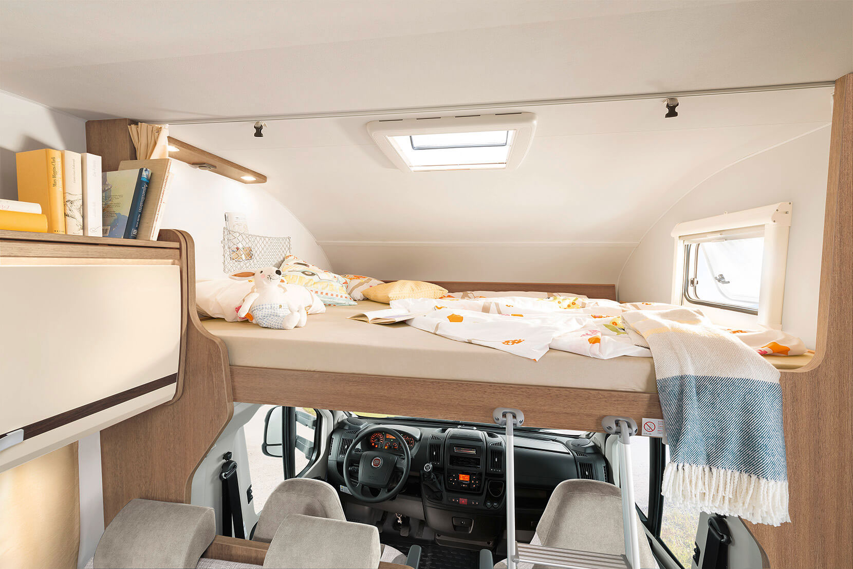 The huge overcab bed (210 x 165 cm) is loved by children and adults alike